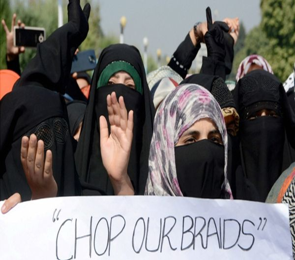 women protesting against alleged braid chopping incidents