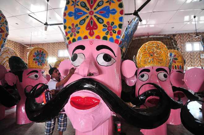Mohd Gayasuddin gives final touches to an effigyof Ravana in Jammu.